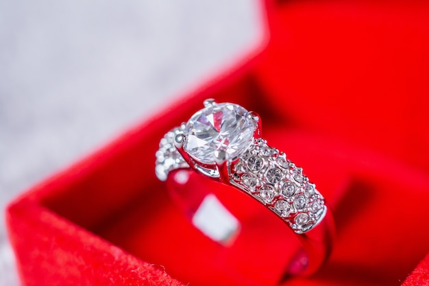 Engagement diamond ring in red jewelry gift box