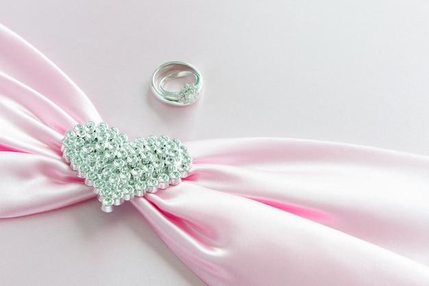 Engagement ring, pink ribbon and diamond heart
