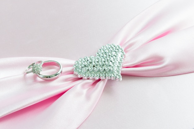 Engagement ring , pink ribbon and dimon heart