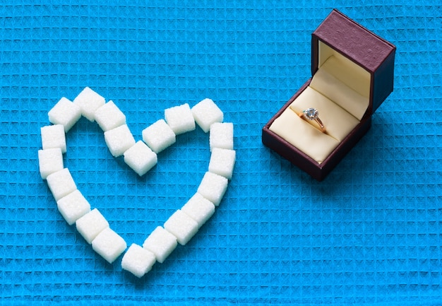 Engagement ring and sugar hearts