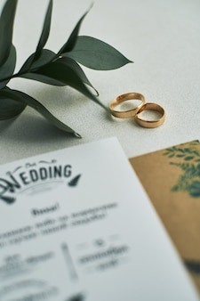 Engagement ring on wedding invitation