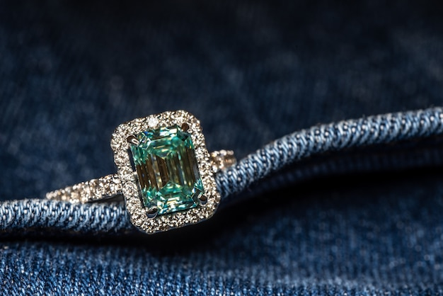 Engagement ring with blue gemstone