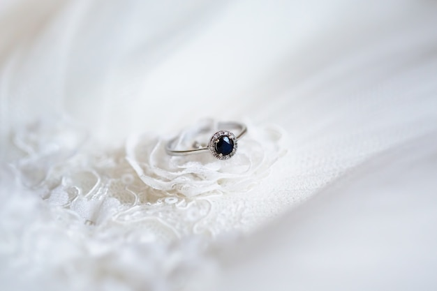 Engagement ring with dark blue sapphire