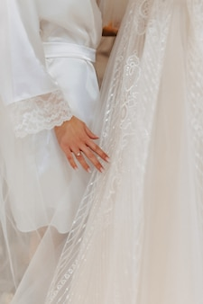 Engagement ring with a stone on the gentle brides hand