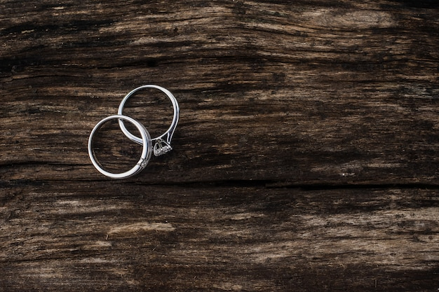 Engagement rings, wedding rings for couples on a wooden background. for wedding , luxury engagement diamond ring  jewelry