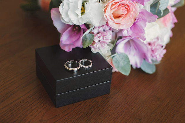 Engagement rings in wooden box.