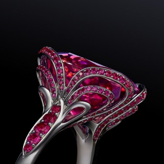 Engagement wedding luxury white gold ring with garnets isolated on black background, included clipping path. extreme close up.