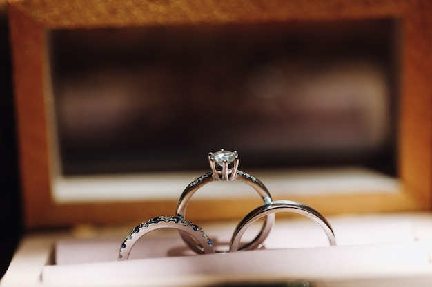 Engagement and wedding rings with precious stones