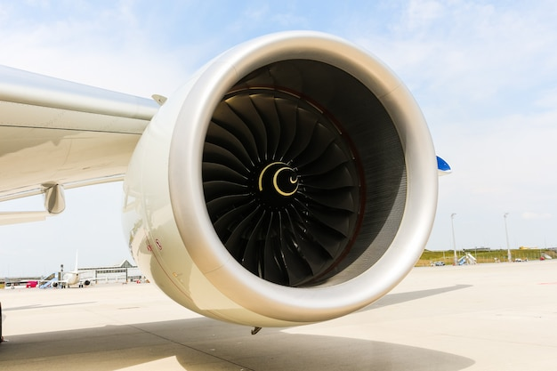Engine of modern passenger jet airplane. rotating fan and turbine blades.