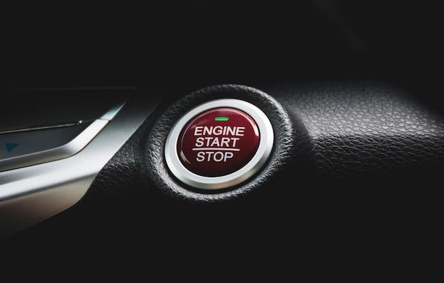 Engine start / stop button of luxury car, automotive part concept.