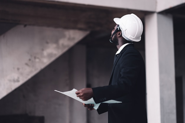 Engineer african man looking the unfinished building