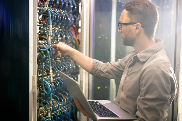 Engineer analyzing server connections