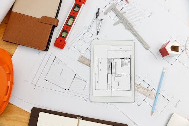 Engineer and architect concept, top view of interior designer desk with blueprint