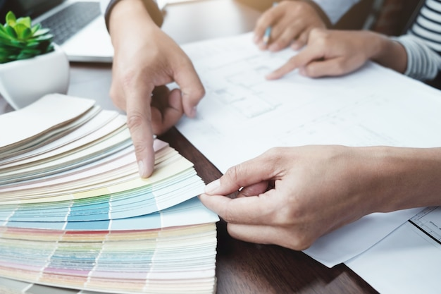 Engineer and architecture select color for house project.
