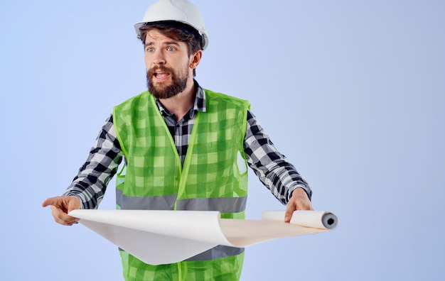 Engineer building uniform white hard hat drawing in hands working project at home