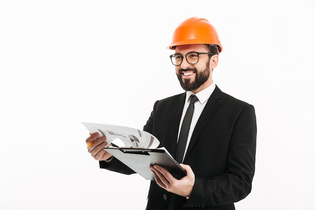 Engineer businessman in helmet holding documents.