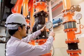 Engineer checking Condenser Water pump and pressure gauge