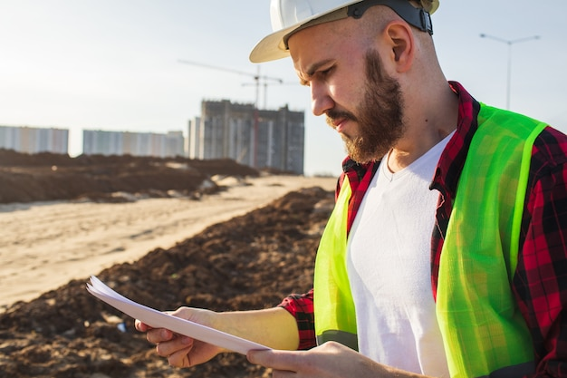 Engineer checking construction site plans