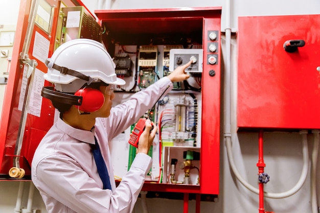 Engineer checking industrial fire control system, fire alarm controller.