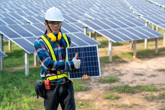 Engineer checking solar panel in routine operation at solar power plant,solar power plant to innovation of green energy for life adjustment.