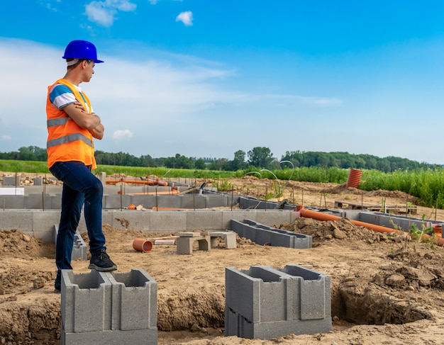 Engineer on the construction of foundations of the building. copy space