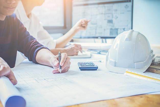 Engineer design working on blueprint planning concept.