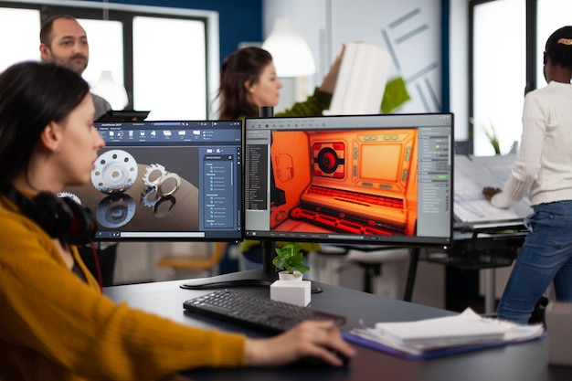 Engineer developer analyzing cad software to develop creative video game