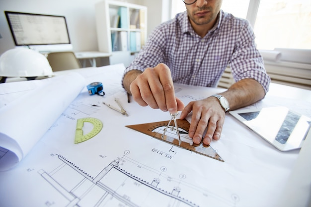 Engineer drawing plans close up