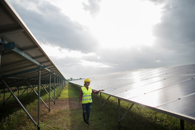 Engineer electric woman checking and maintenance of solar cells.