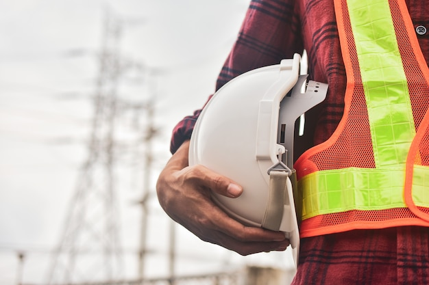 Engineer holding white helmet safety hard hat copy spec