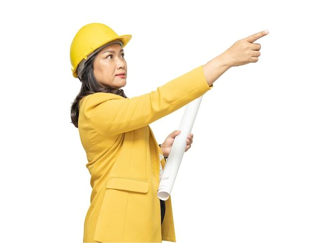 Engineer holding yellow helmet with blueprint isolated
