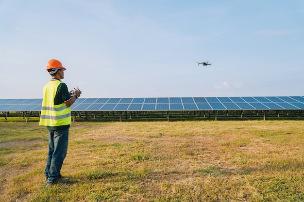 Engineer inspect and checking solar panel by drone at solar power plant