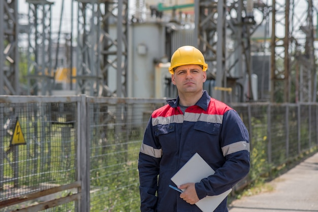 Engineer inspecting the equipment of the substation