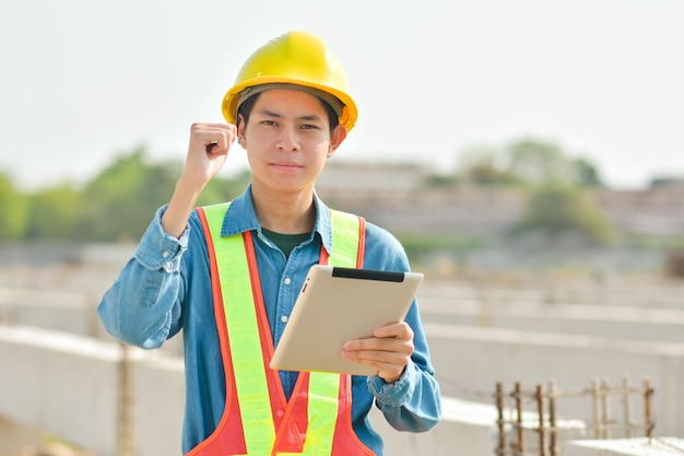 Engineer inspector on  site construction by tablet technology