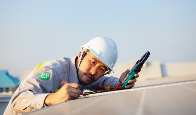 Engineer inspects solar panels on roof of modern house. alternative energy ecological concept.