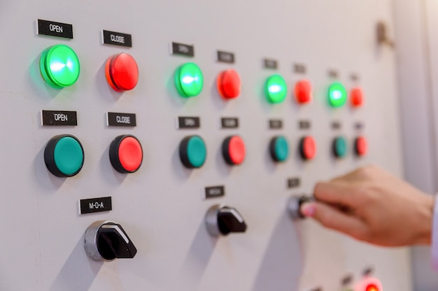 Engineer is check electrical control panel in factory / control panel system ready.