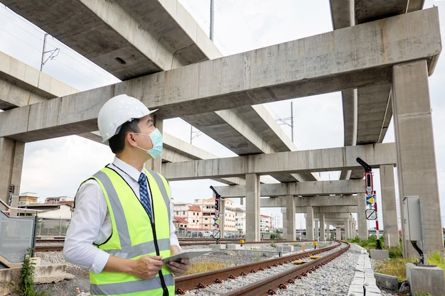 Engineer is checking on infrastructure and construction site.