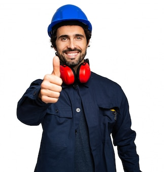 Engineer isolated on white giving thumbs up