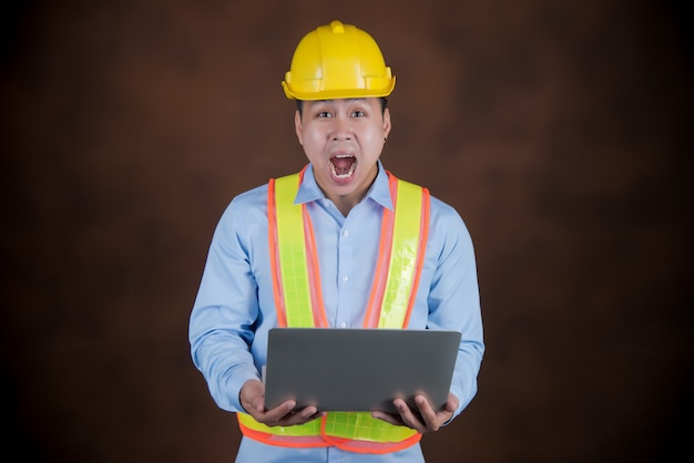 Engineer man, construction worker scared in shock