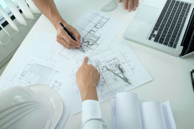 Engineer meeting for architectural project.