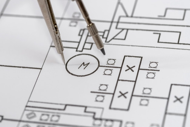 Engineer's drawing on white paper as surface close up