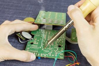 Engineer soldering electronic components
