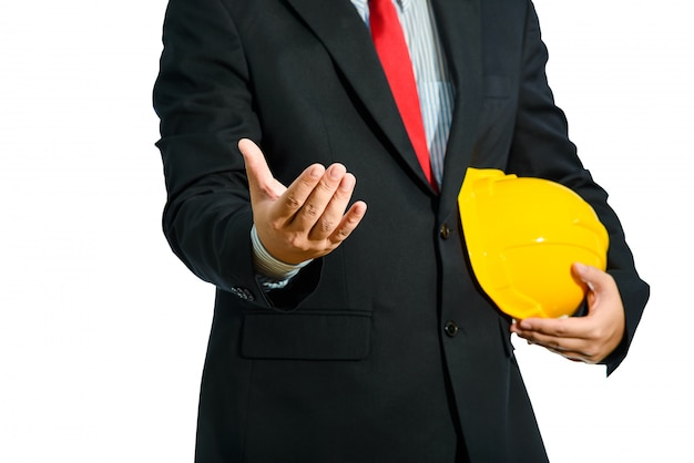 Engineer in suit holding helmet isolated