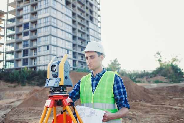 Engineer surveyor with a drawing