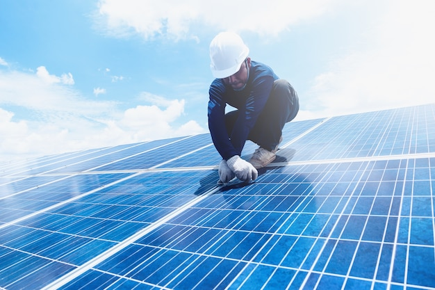Engineer team working on replacement solar panel in solar power plant