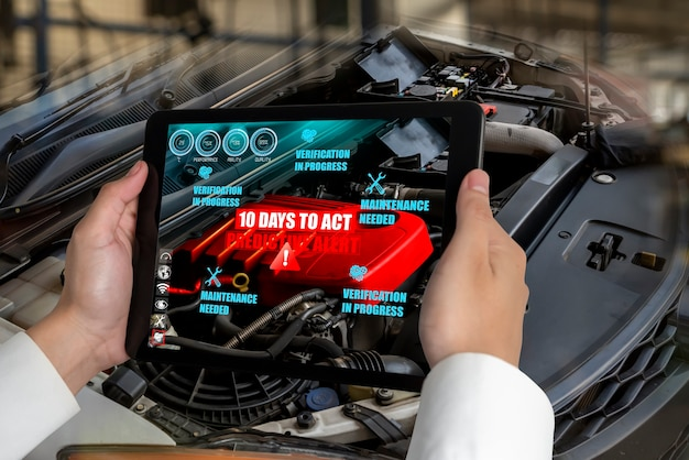 Инженер использует программное обеспечение с дополненной реальностью для мониторинга частей автомобиля