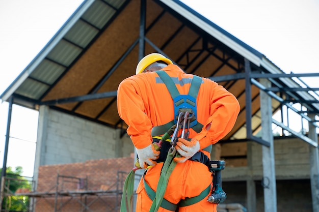 Engineer wearing safety harness and safety line