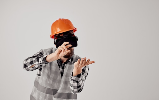 Engineer with hard hat and vest using virtual reality headset
