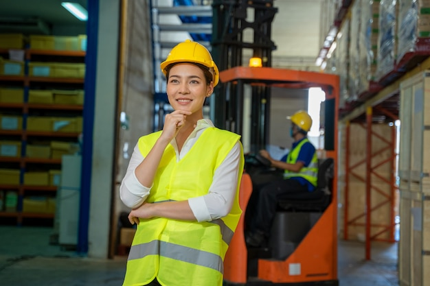 Engineer women working in a large warehouse, wholesale, logistic, people and export concept.
