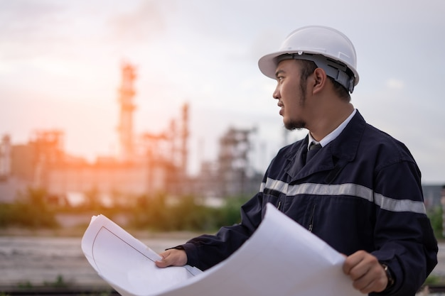 Engineer worker concept working at oil refinery.